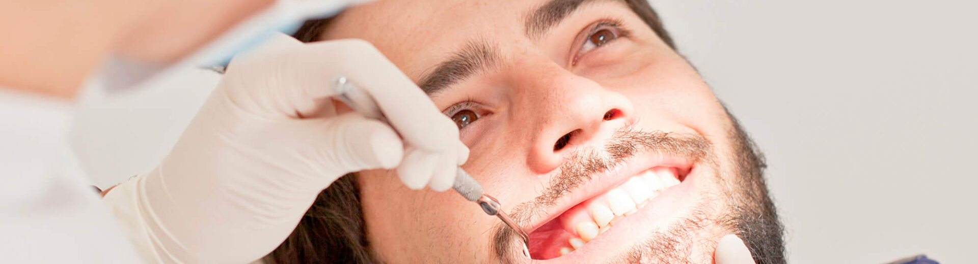 young-happy-man-and-woman-in-a-dental-examination-at-dentist